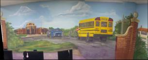 Mural depicting WPA era school and modern school bus.